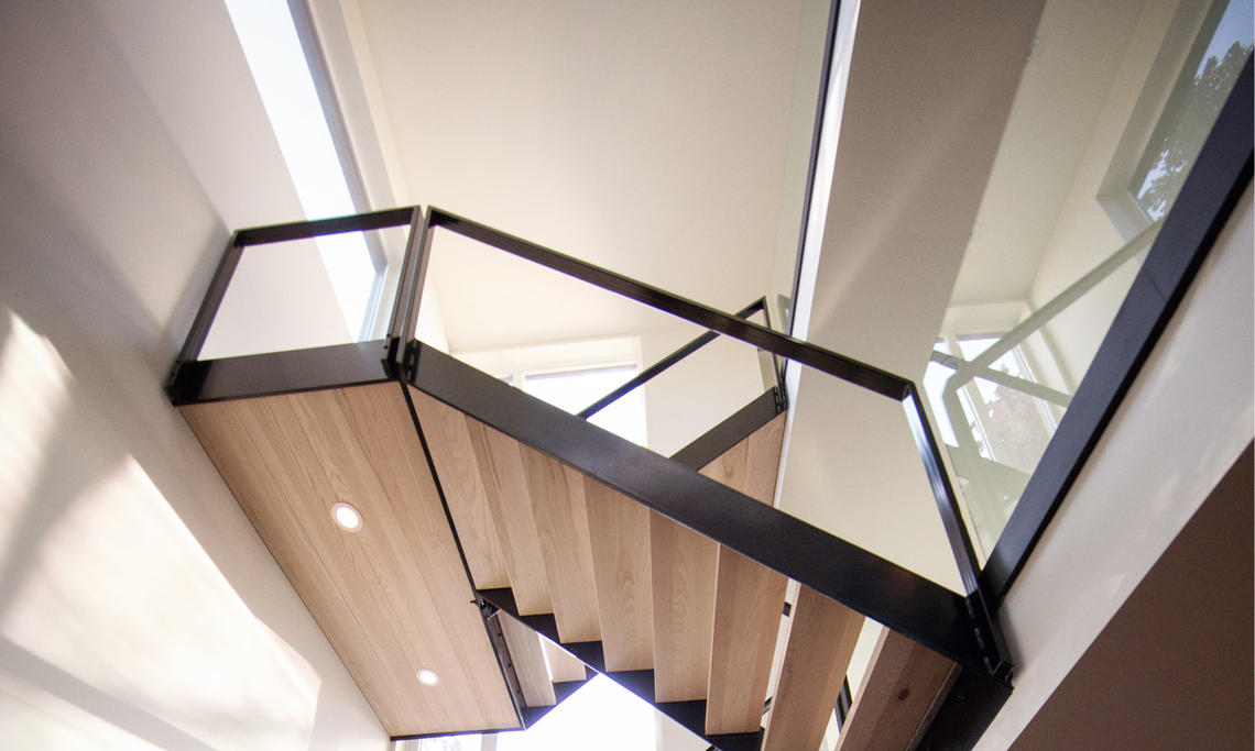 A light-filled stairwell in a Bioi Design + Build home in northeast Calgary.